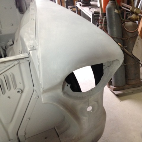 1956 Chevy truck fender repair after primer applied.