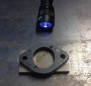 Diagnostic tools: a flashlight and a flat piece of metal.