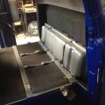 seat belts, fuel tank, carpet, and mats installed