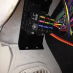 Fuse box above driver-side kick panel.